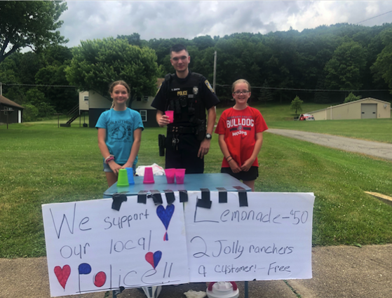 "BrayLynn Rearick and Shaylee Rupp wanted to have a lemonade stand and donate the money towards the New Bethlehem Police Department for the K9 Officer Fund.  They wanted to do this to thank the Officers.  Shaylee said, ""so many people think police are bad and they are not all bad.  Officer John Smith stopped and played volleyball with us one day at Gumtown Park"" They wanted to do something nice for the police. Pictured with the girls is Officer Taylor Smith. Photo submitted by Lisa Kerle."
