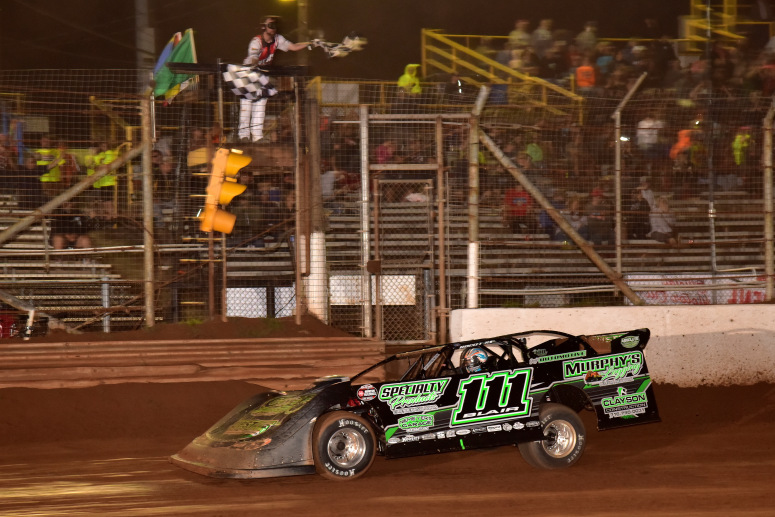 Max Blair of Titusville takes the checkers as he defeats the World of Outlaws (Paul Arch photo)