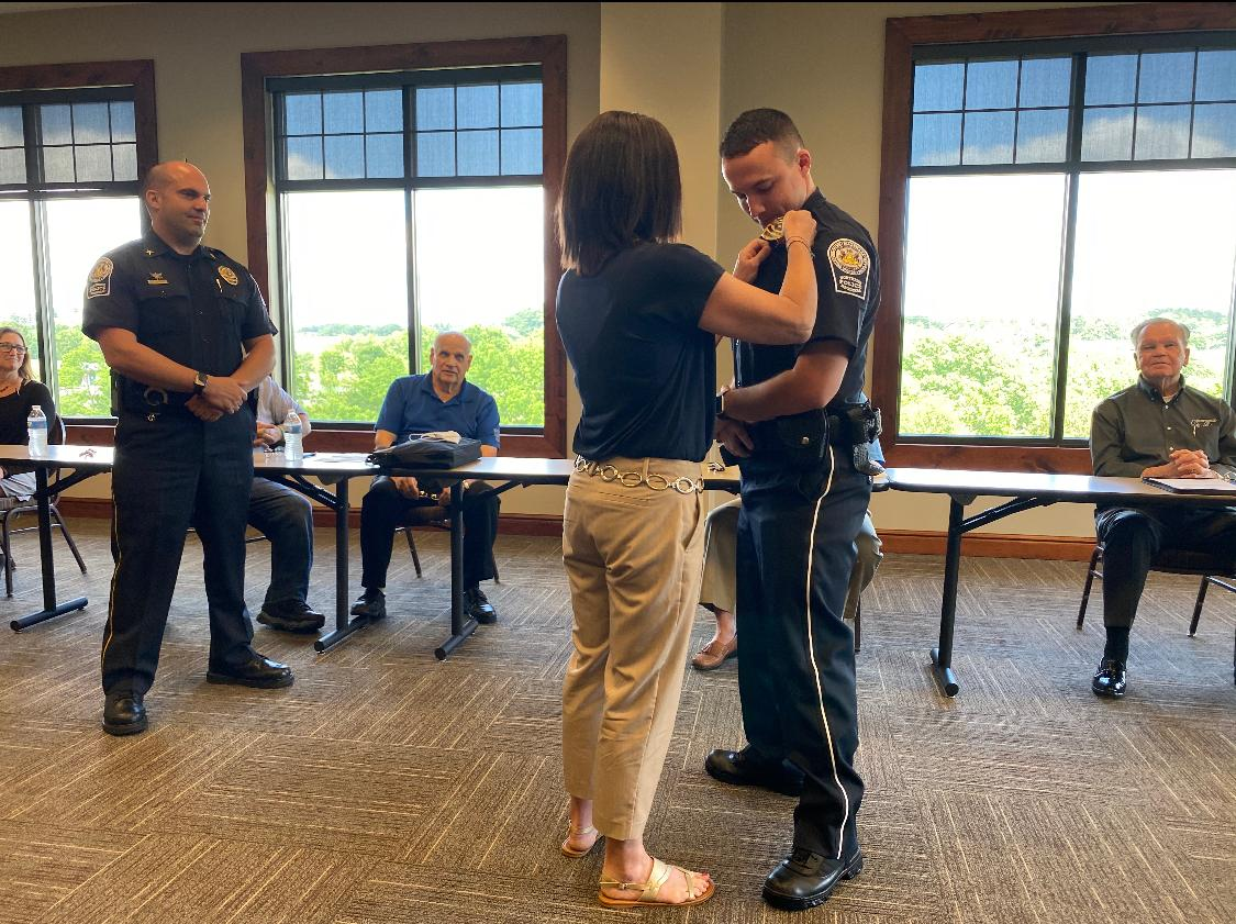 """""""Pinning In"""" Ceremony where Corbin receives his badge the first time. Badge pinned on by mother Melissa Anderson. Chief John A Sicilia standing in background."""