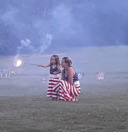 Shelby Collett and her daughter, Ellie, in their American flag matching dresses putting off small fireworks until night falls for the big fireworks. Submitted by Shelby's mother, Shanon Bentley. Clarion Co. photo of the day is brought to you by Window World of Butler.