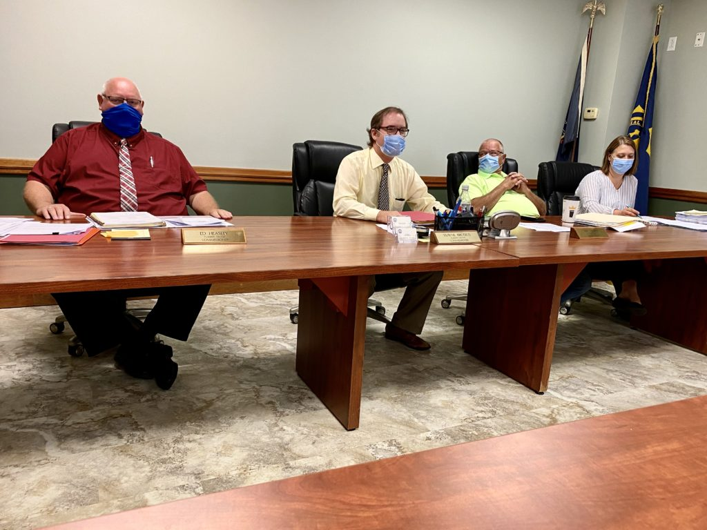 commissioners with masks