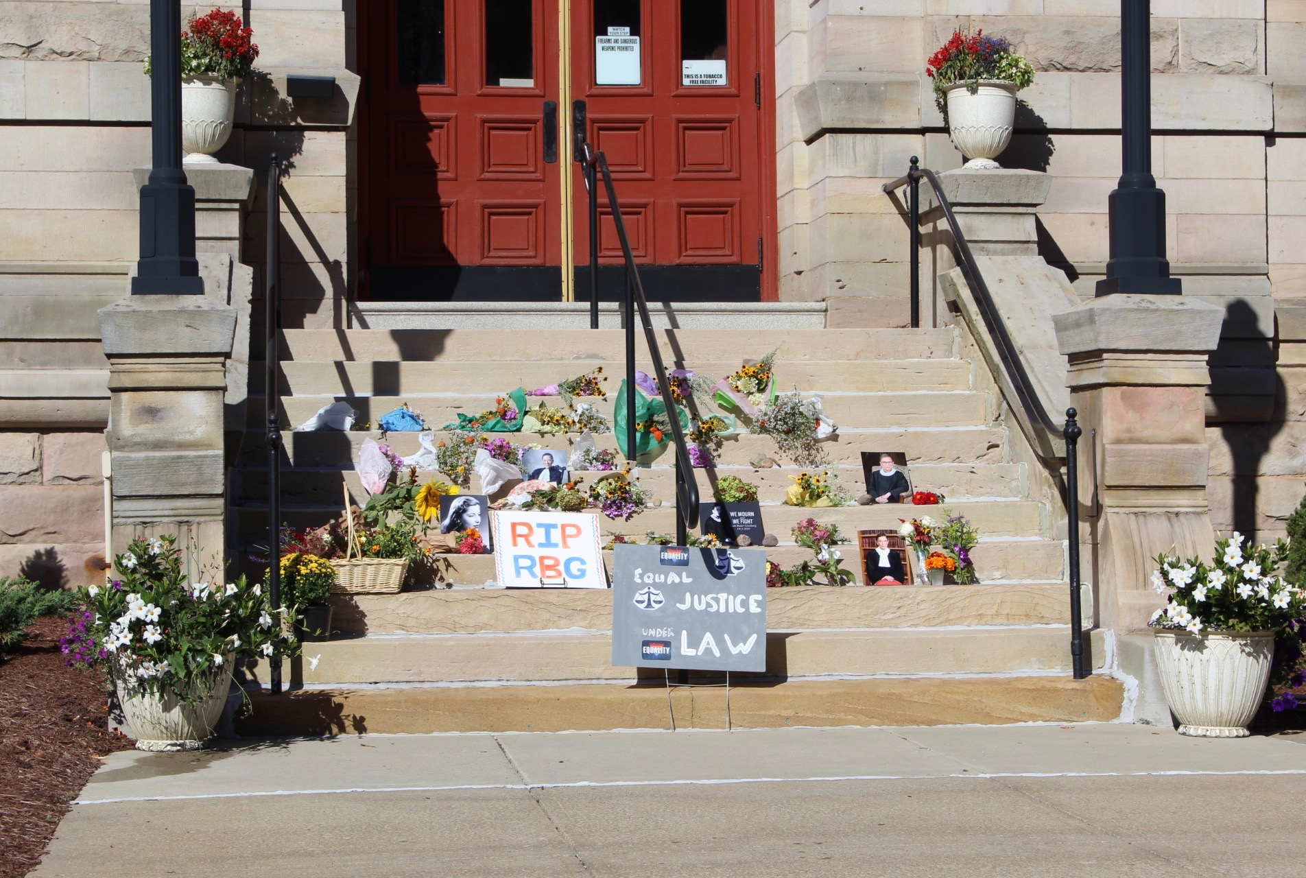 Clarion County residents left condolence gifts on the courthouse steps on Sunday in remembrance of Supreme Court Justice Ruth Bader Ginsburg. Submitted by Lynn Ramsey.