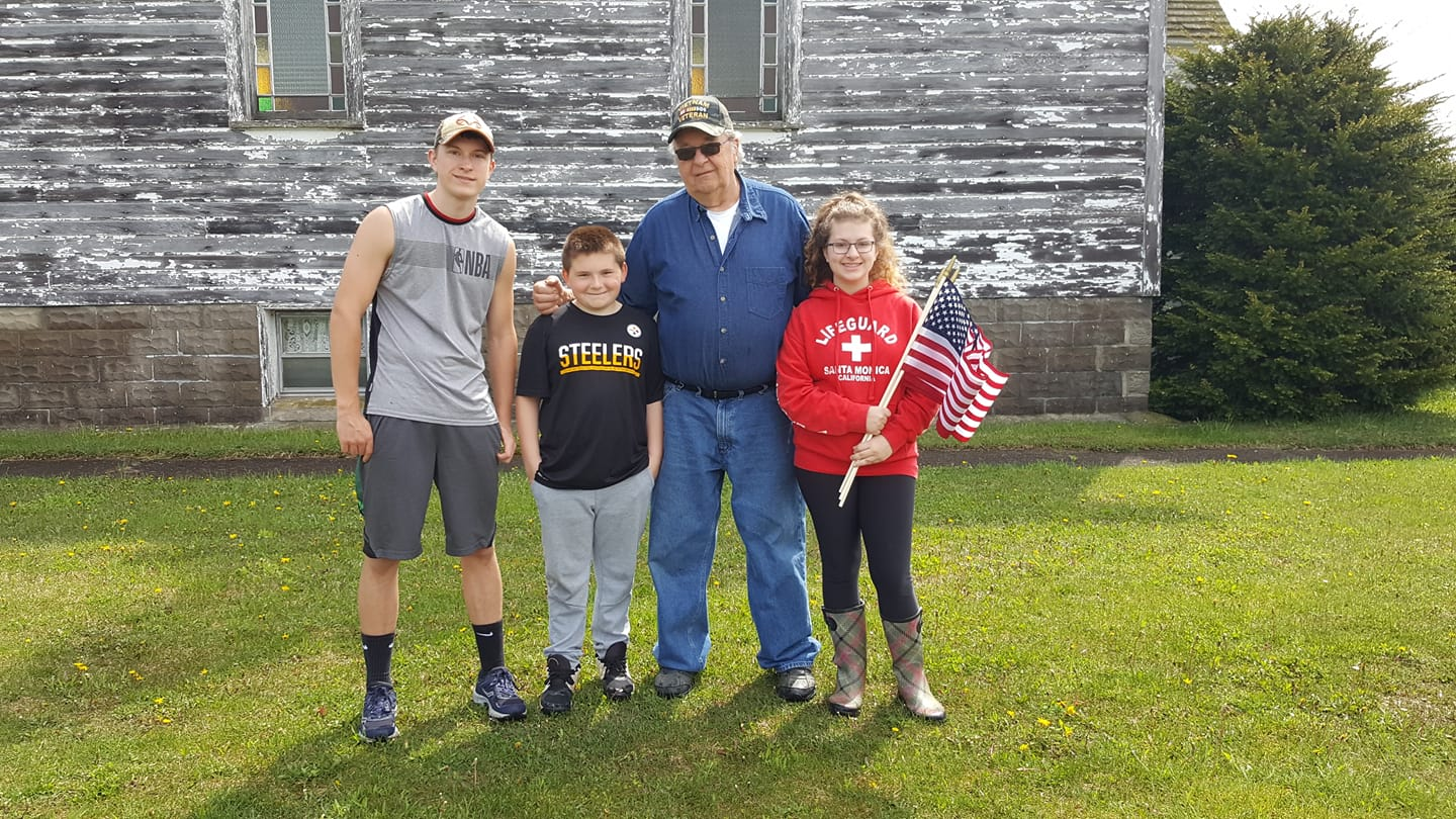 """Every year Larry Ritts, a Vietnam Vet, and his grandchildren replace flags on the graves of all Veterans before Memorial Day. One of our favorite things to do!! Happy Veterans Day, Dad!!!"" Submitted for Veterans Day by Karyn Montana."