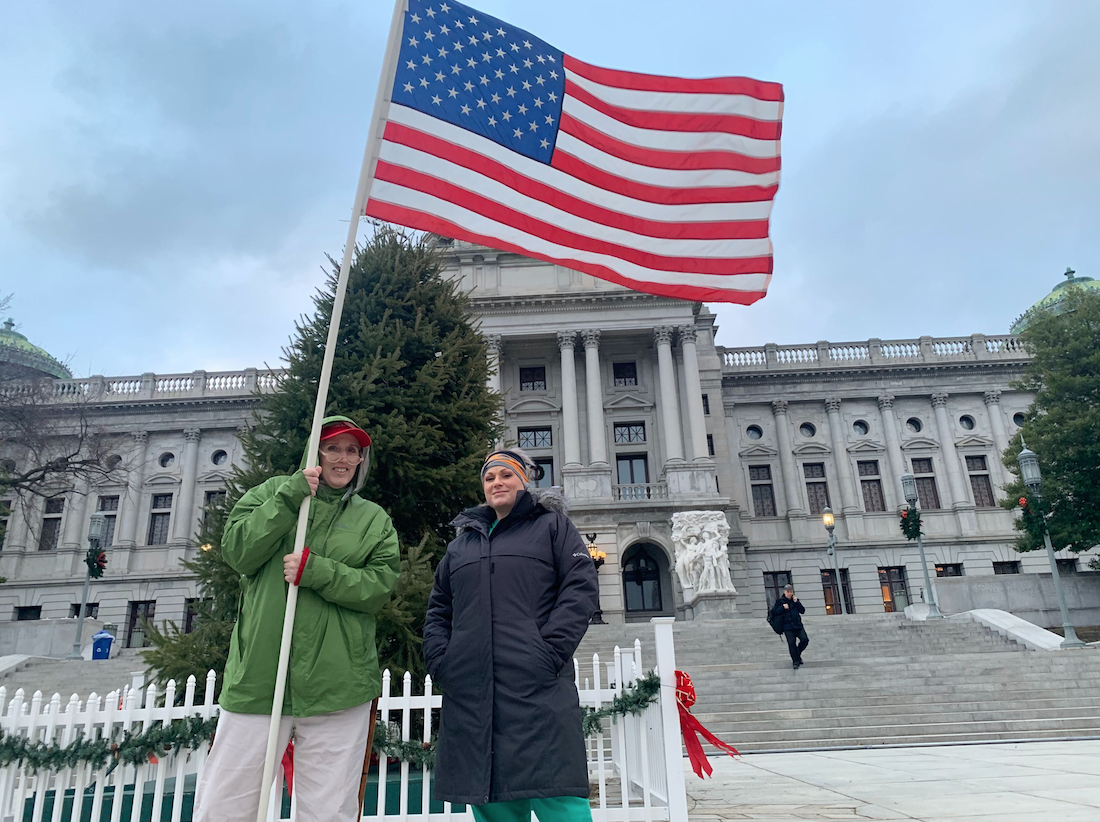 """""""I'm here because our election has been stolen in every possible way,"""" Ann Van Tassel (left, in green) said. Photo credit: Charlotte Keith/Spotlight PA."""