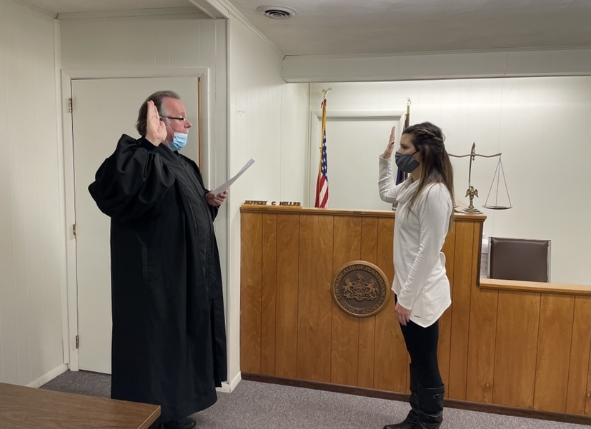 Officer Gathers at her swearing in ceremony in New Bethlehem, with Judge Miller.