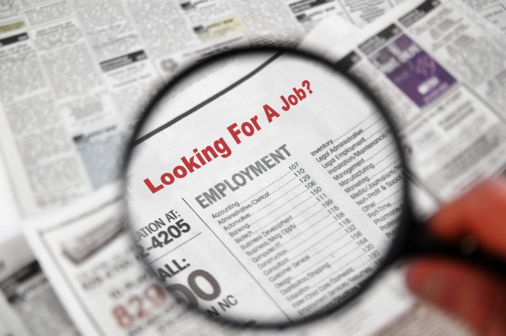 Magnifying,Glass,Over,Jobs,Section,Of,Newspaper,Classifieds