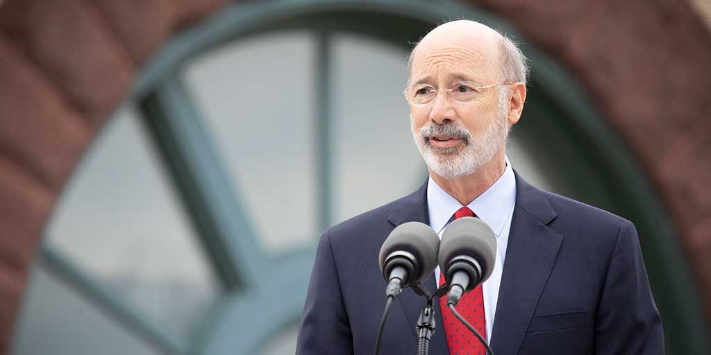 Governor-Tom-Wolf-standing-in-front-of-a-building