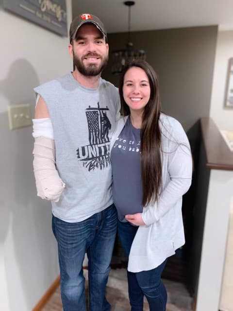Branden Bauer, a local lineman who was severely electrocuted earlier this year, recovering with his wife Katelyn by his side. Courtesy of Praying for Branden.