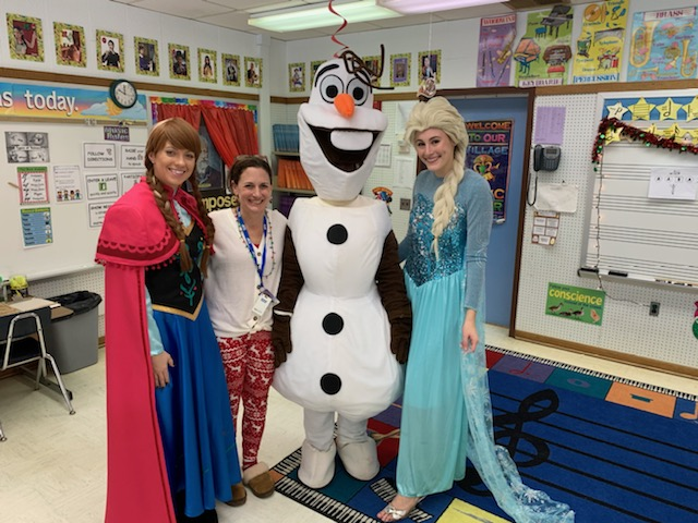 Mrs. Reisinger, North Clarion elementary teacher; Samantha Schmader; Ann Smerkar as Olaf; and Abigail Schmader at an elementary school Christmas party.
