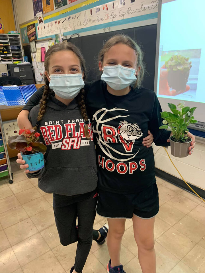 Students in Mrs. Jamie Bowersox's 4th grade class recently made Mother's Day cards and planted flowers in an array of brightly colored pots for their moms. Courtesy of Redbank Valley Education Association.