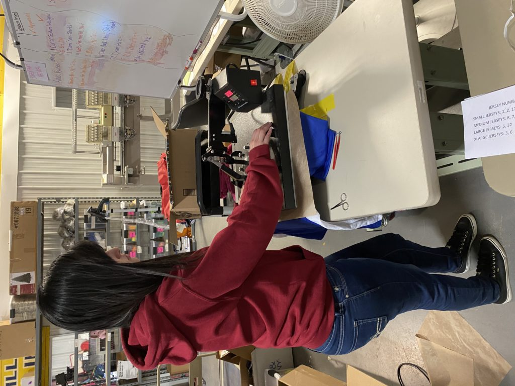 Pictured:  BGM Team's Kari is heat pressing a personalized t-shirt.