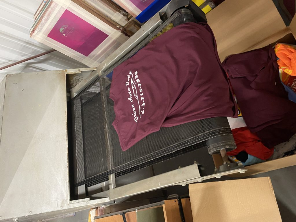 Pictured: A  personalized shirt coming out of the oven at BGM Custom Wear.
