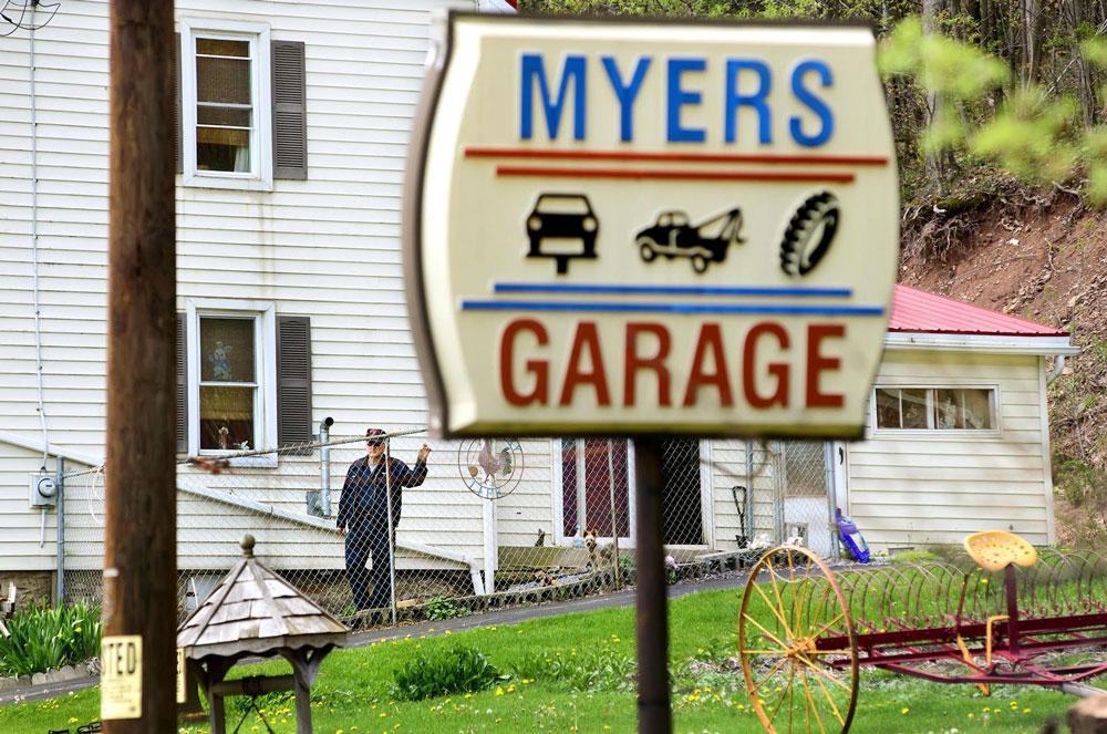 John Myers, whose son shot at BLM activists in August, stands outside his home and garage. Photo credit: Thomas Slusser/The Tribune-Democrat, Johnstown, Pa.