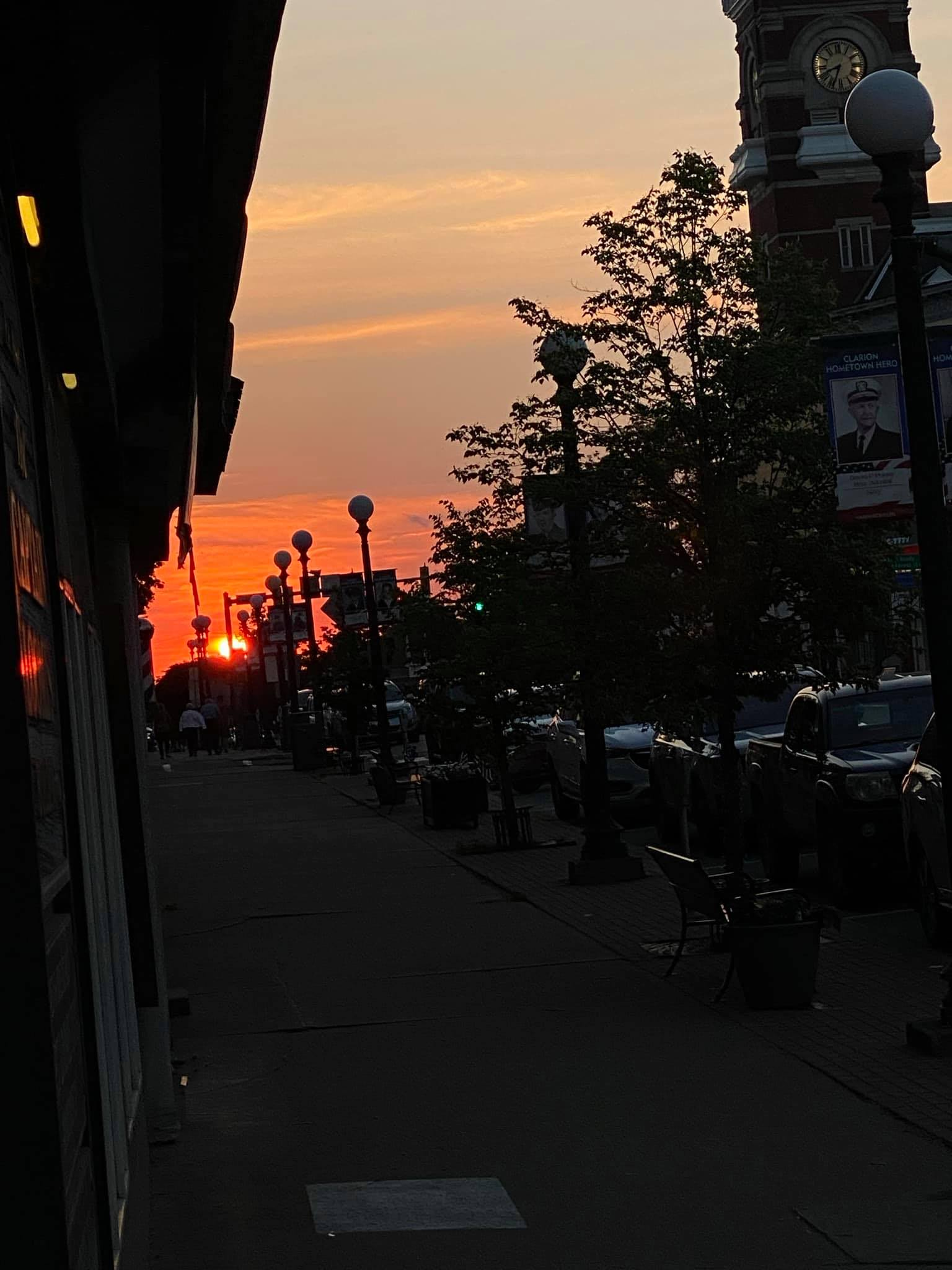 Main Street in Clarion glows an orange hue as sunsets between the buildings. Photo submitted by Chloe Wolfe.