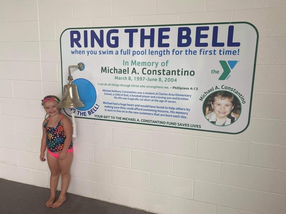 """Hadley Graybill, """"Rang the Bell"""" after a successful lap in the Clarion County YMCA pool this week. She has been taking swim lessons through the YMCA. Photo courtesy of the Clarion County YMCA."""