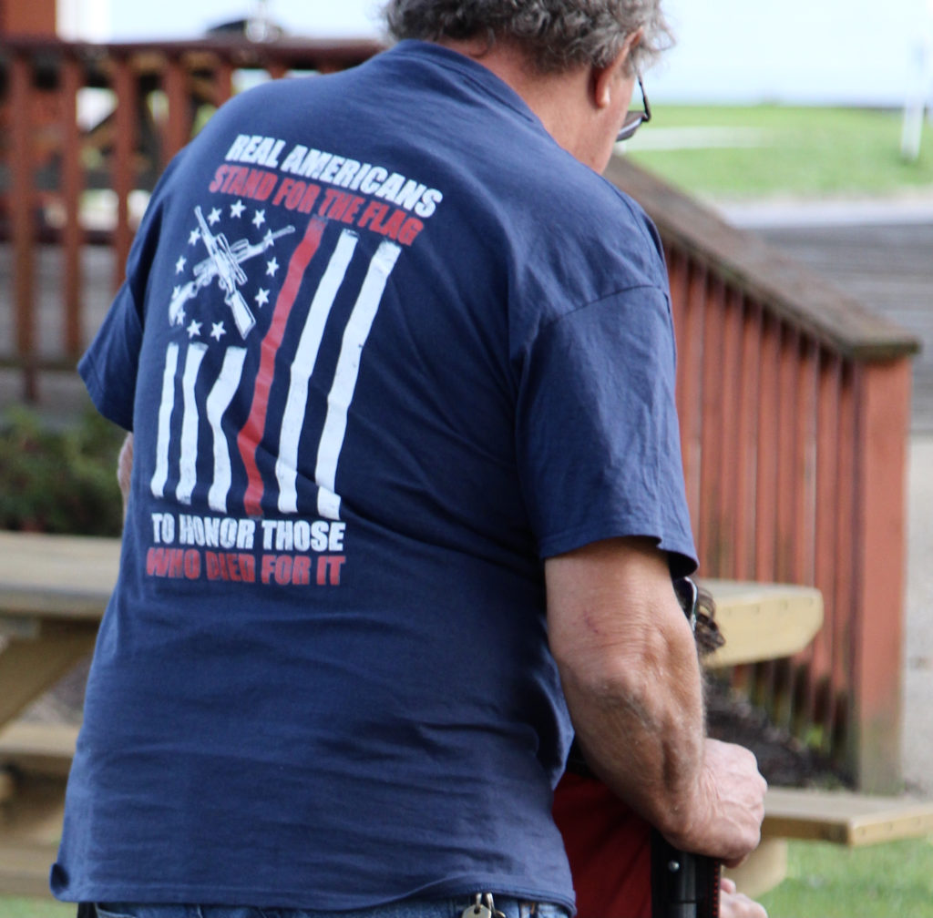 The back of a t-shirt in the crowd tells why we honor those who sacrificed much.