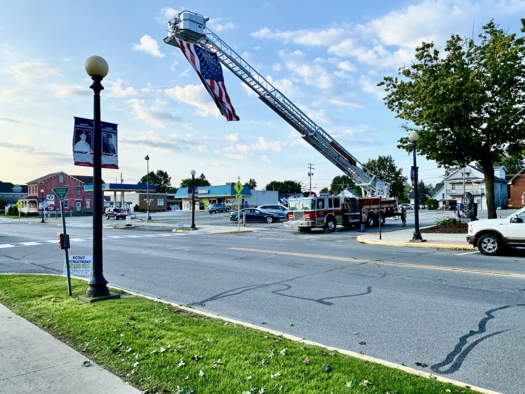 The Clarion Fire Department proudly displays a large flag on Main Street.