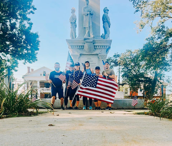A group of friends from the Clarion Area ran a mile together while holding American Flags on 9/11. Courtesy of Samantha Lutz.