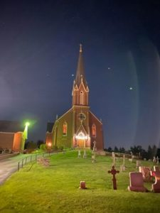 St. Joseph in Lucinda lit up in the dark. Submitted by Matthew Hummel.