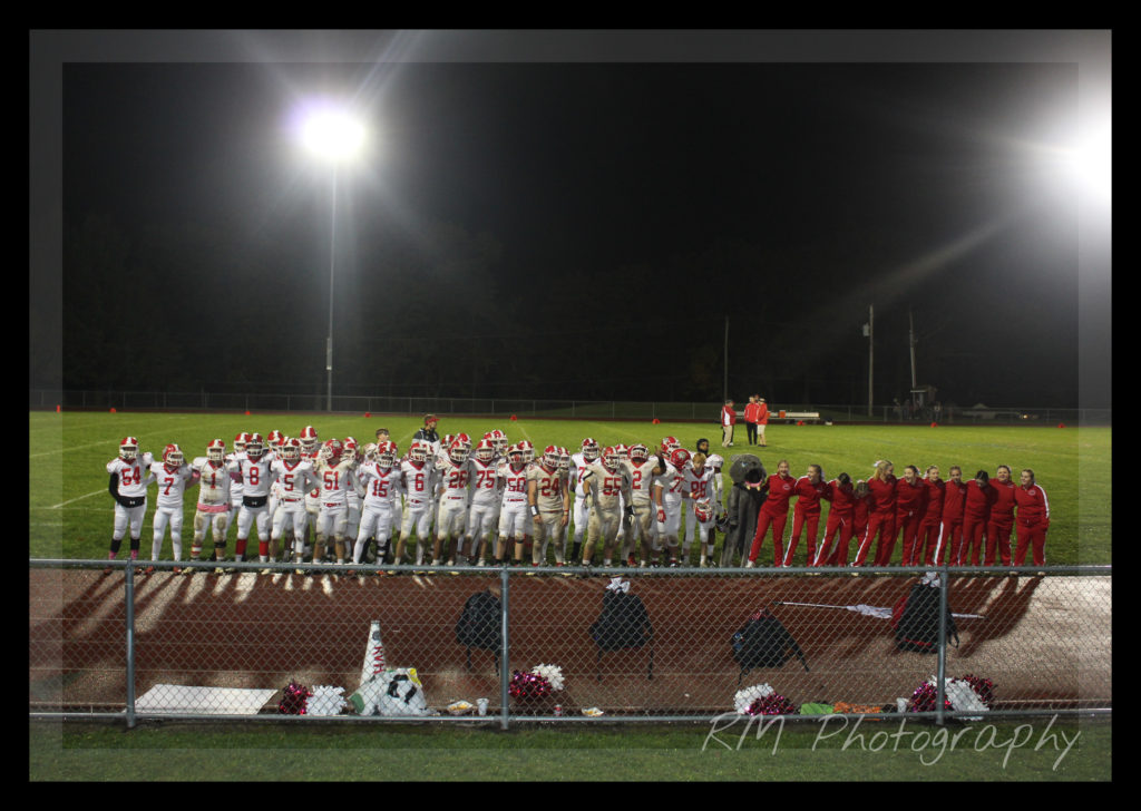 Redbank Valley football players and cheerleaders gather to celebrate the team's victory over Union-AC Valley on Friday. Photo by Amanda Mertzeis.